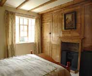 image: first floor bedroom with panelling